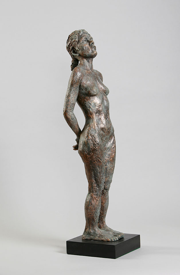 "Standing female on solid footing with back bend and thoughtful contemplation in cast resin 27""x6.5""x6.5"""