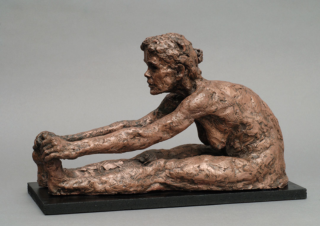 Mature female seated figure with hands over out stretched legs in concrete by William Casper.