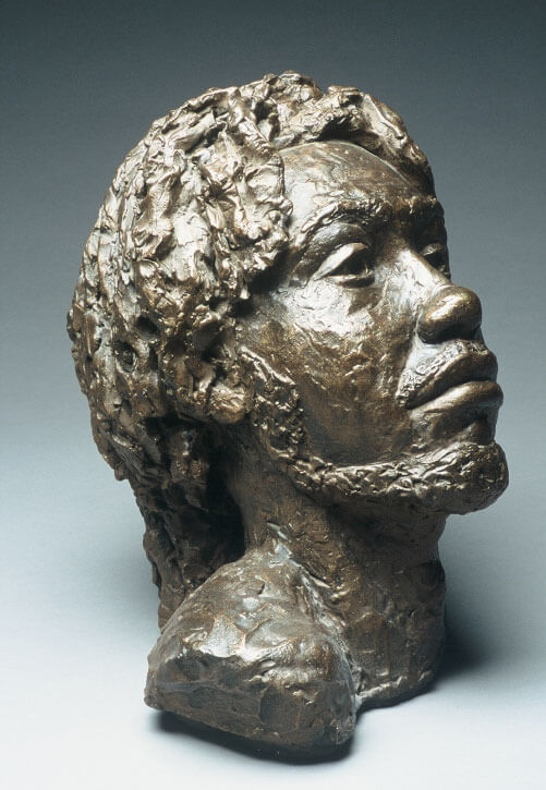 Bust of male from the Caribbean side view in painted plaster cast by William Casper.