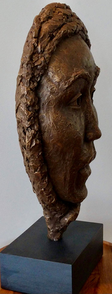 Bust of stylized female side view in cast resin by William Casper.