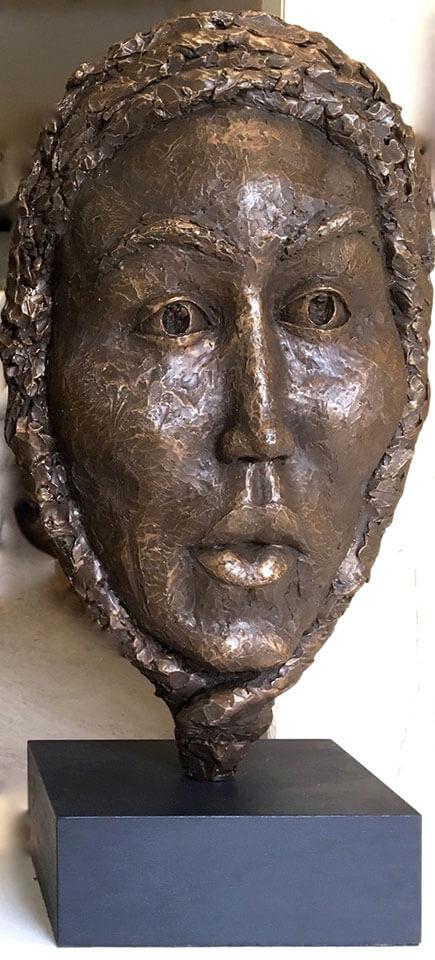 Bust of stylized female in cast resin by William Casper.