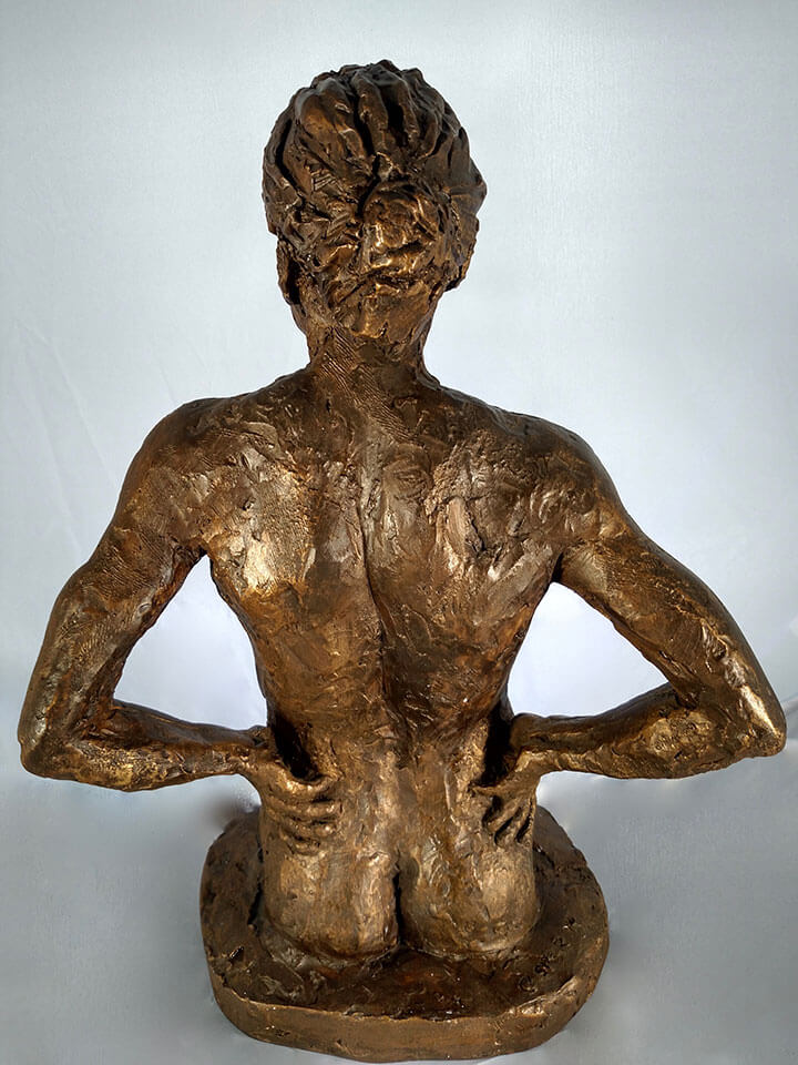 Female with hands on hips looking confidently rear view in resin cast by William Casper.
