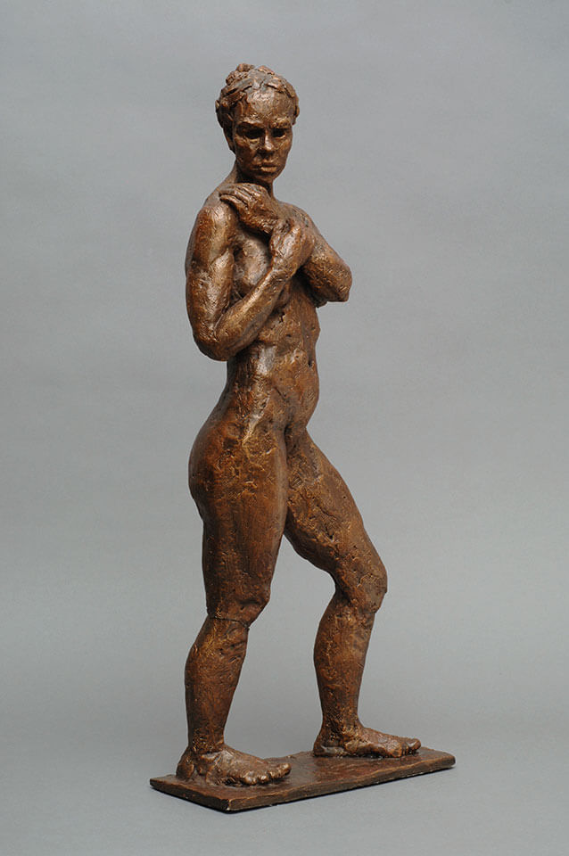 Female standing looking over right shoulder holding left wrist side view in cast resin by William Casper.