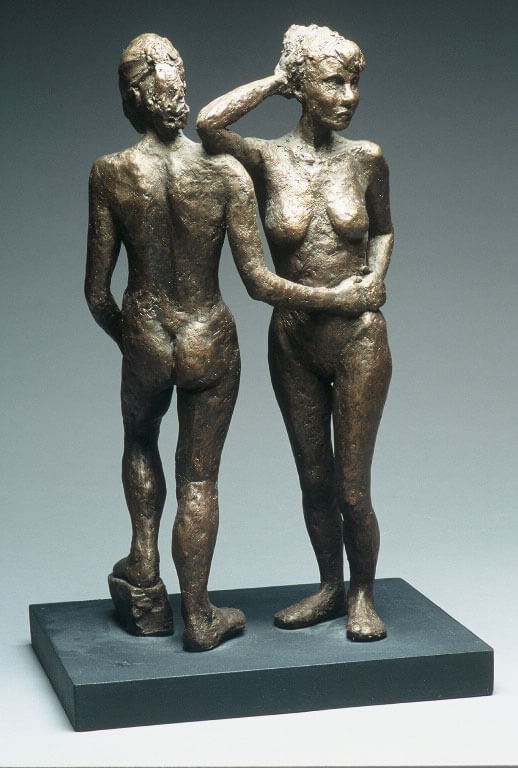 Two female standing figures holding each other in opposite directions reverse view in cast resin by William Casper.