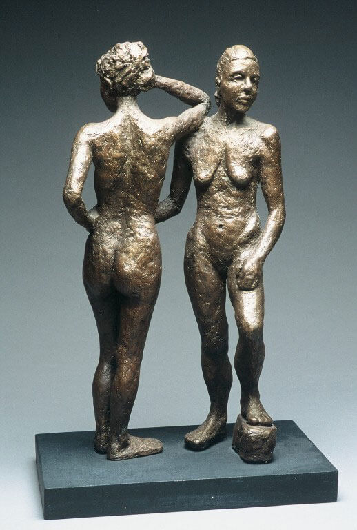 Two female standing figures holding each other in opposite directions in cast resin by William Casper.