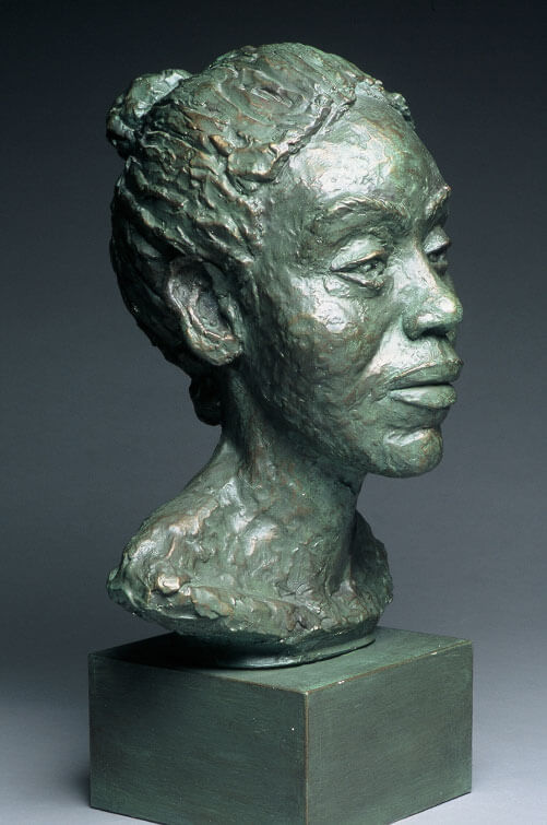 Bust of female side view in painted plaster cast by William Casper.