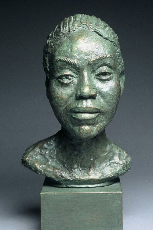 Bust of female in painted plaster cast by William Casper.