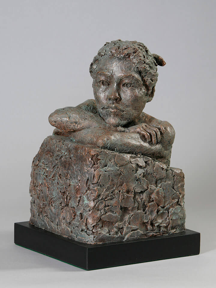 Japanese female bust with crossed arms looking over a wall in resin cast by William Casper