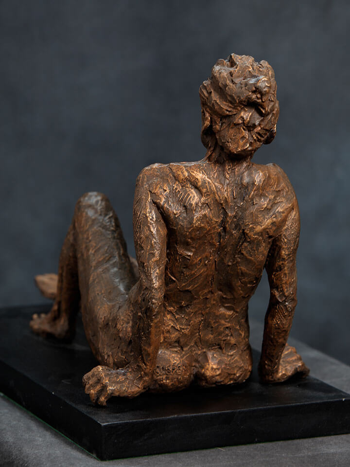 Seated female with leaning back with outstretched legs rear view in cast resin by William Casper