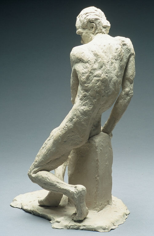 Male figure seated with crossed legs rear view in cast resin by William Casper.