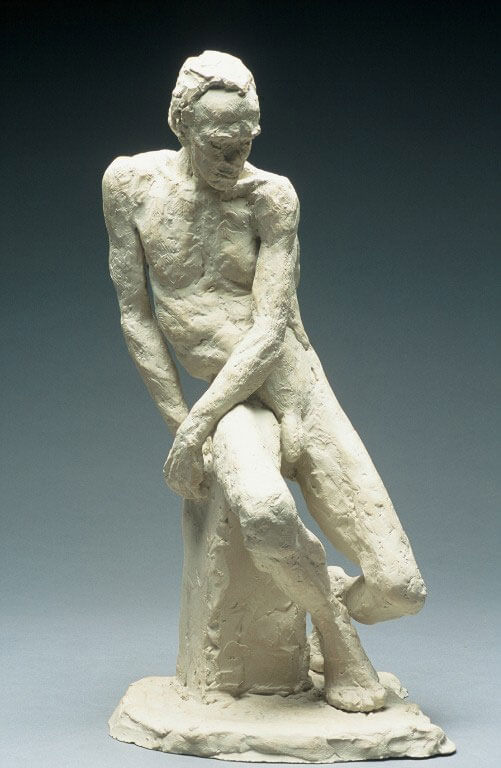 Male figure seated with crossed legs in cast resin by William Casper.