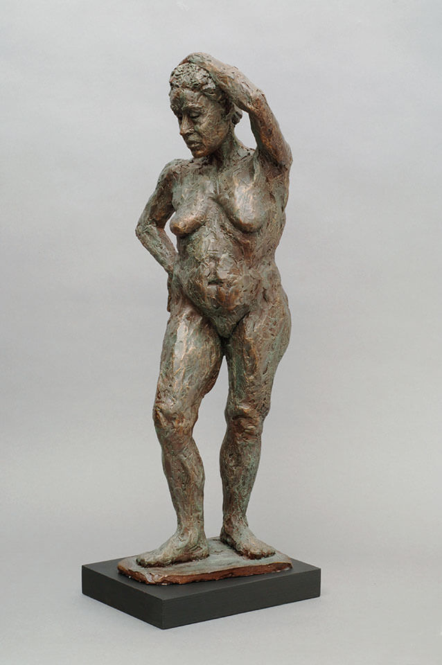 Standing mature woman looking downward in cast resin by William Casper