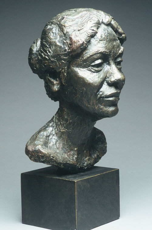 Bust of Pakistani woman side view by William Casper in painted plaster cast.