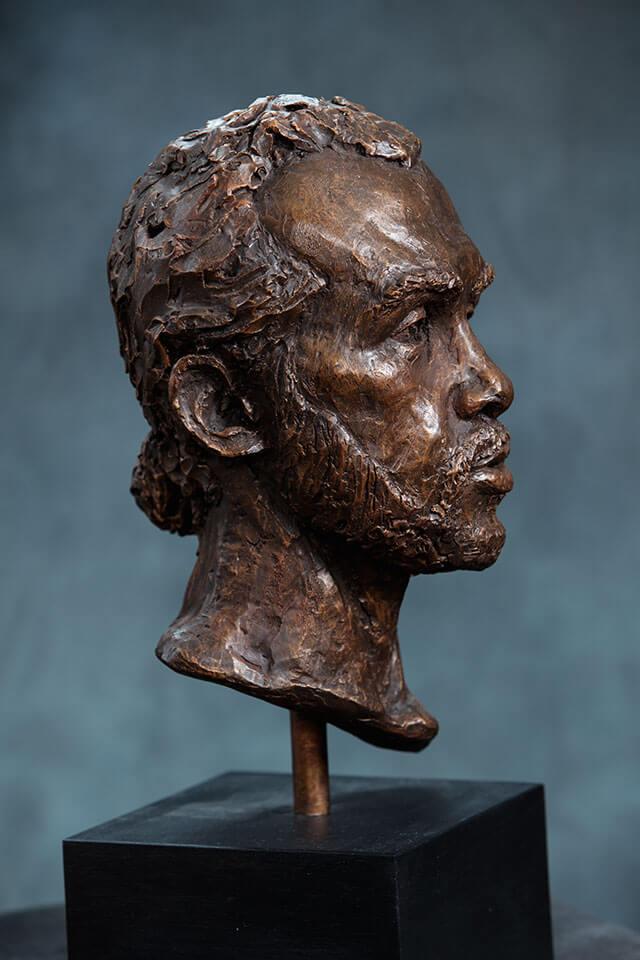 Bearded male bust side view in cast resin by William Casper.