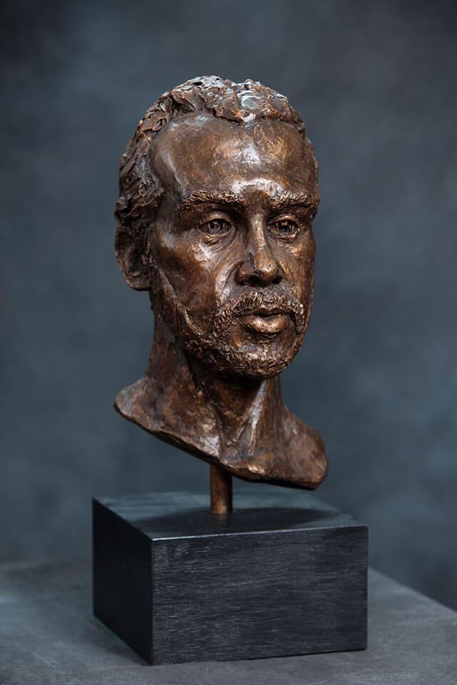 Bearded male bust in cast resin by William Casper.