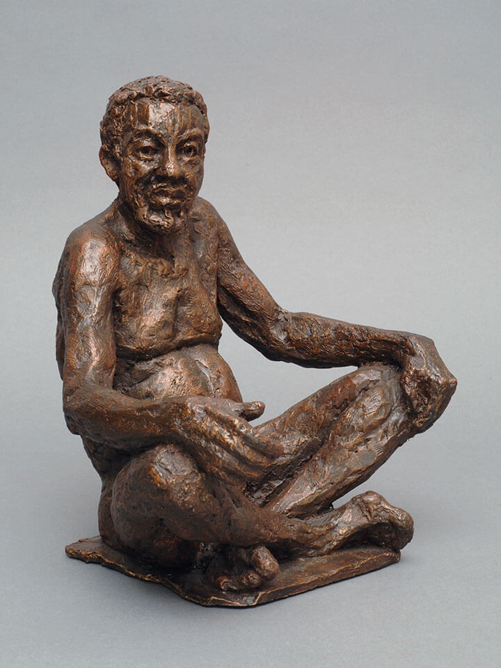 Mature male sitting cross legged with hands on knees side view in cast resin by William Casper