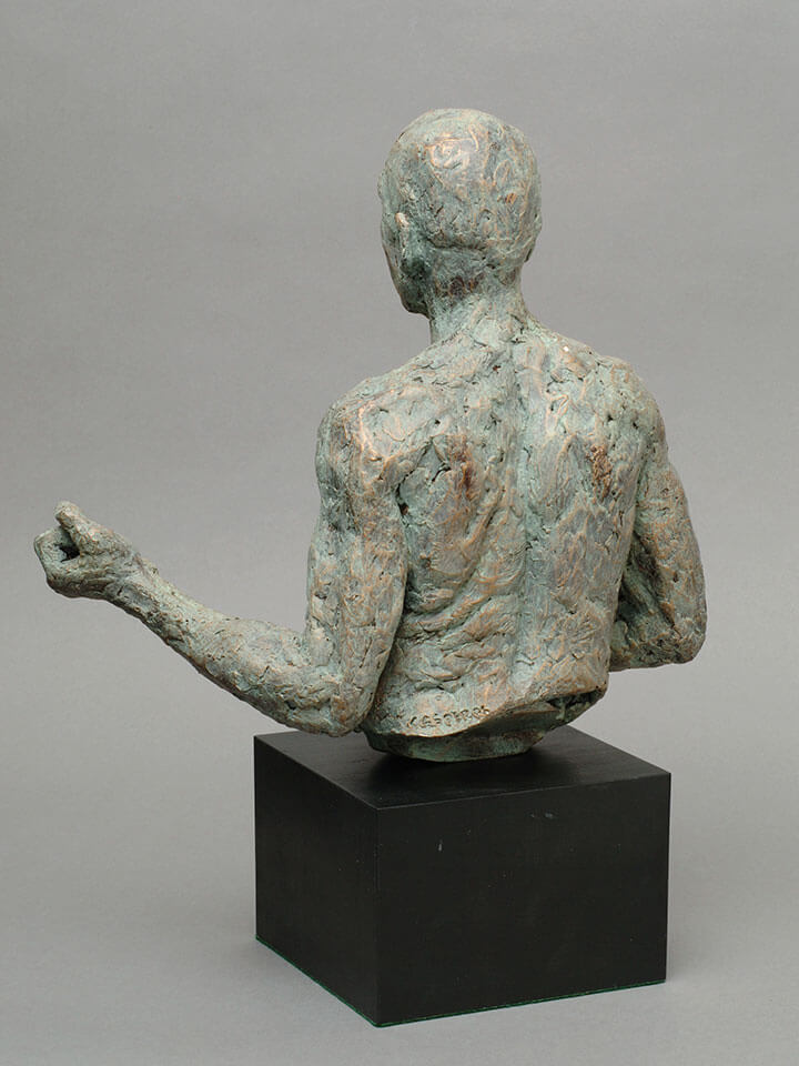 Muscular male torso waist high with clenched hands rear view in cast resin by William Casper.