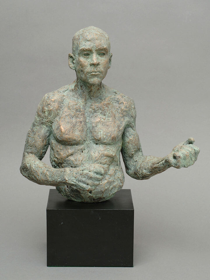 Muscular male torso waist high with clenched hands in cast resin by William Casper.