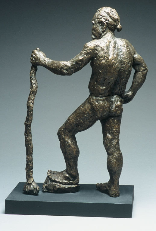 Male figure leaning on walking stick rear view in cast resin by William Casper