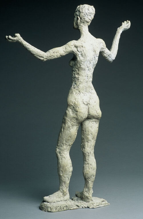 Female standing figure with stylized upper body rear view in cast resin by William Casper.