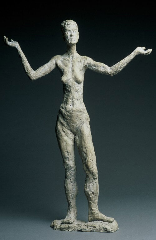 Female standing figure with stylized upper body in cast resin by William Casper.