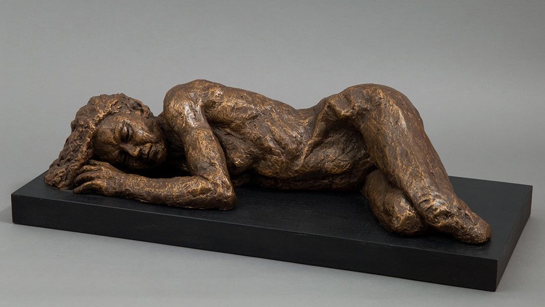 female laying in right side in cast resin by William Casper.
