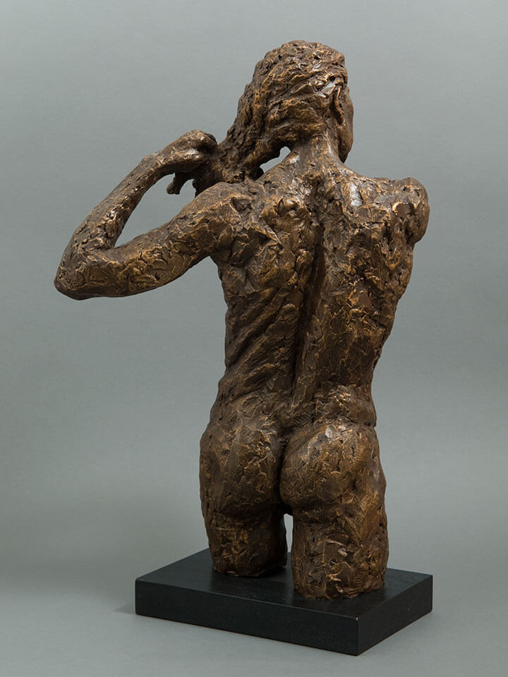 Female fixing hair rear view in cast resin by William Casper.