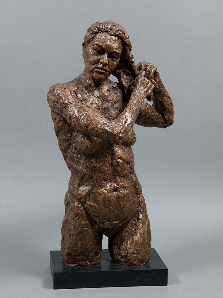 Female fixing hair in cast resin by William Casper.