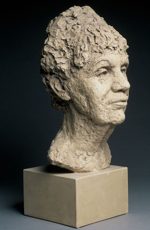 Bust of older woman side view in painted plaster cast by William Casper.
