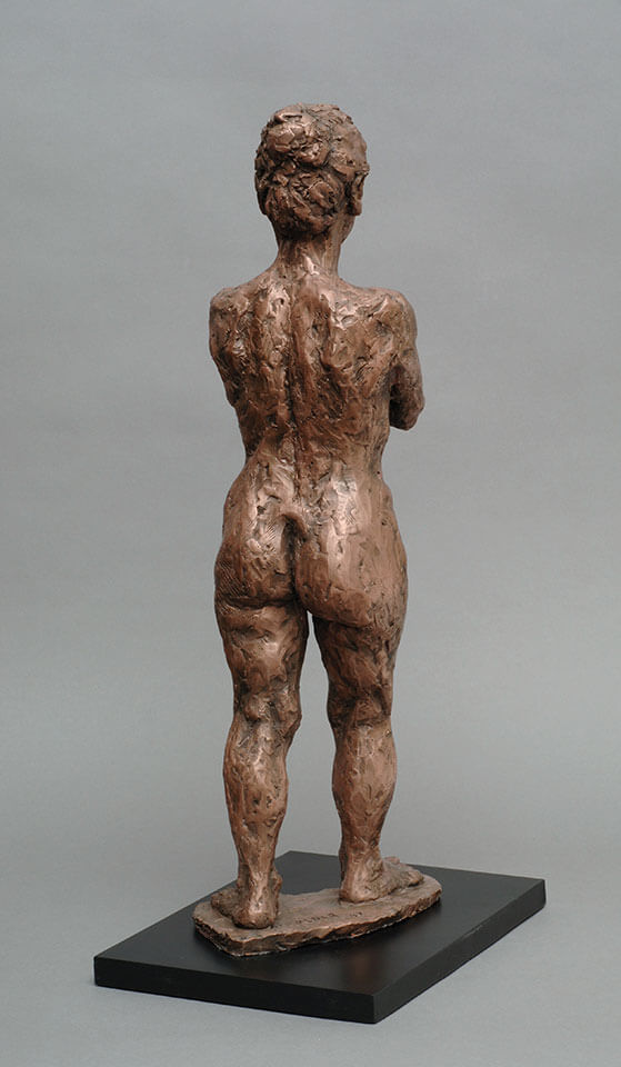 Standing Japanese woman holding hands forward rear view in cast resin by William Casper