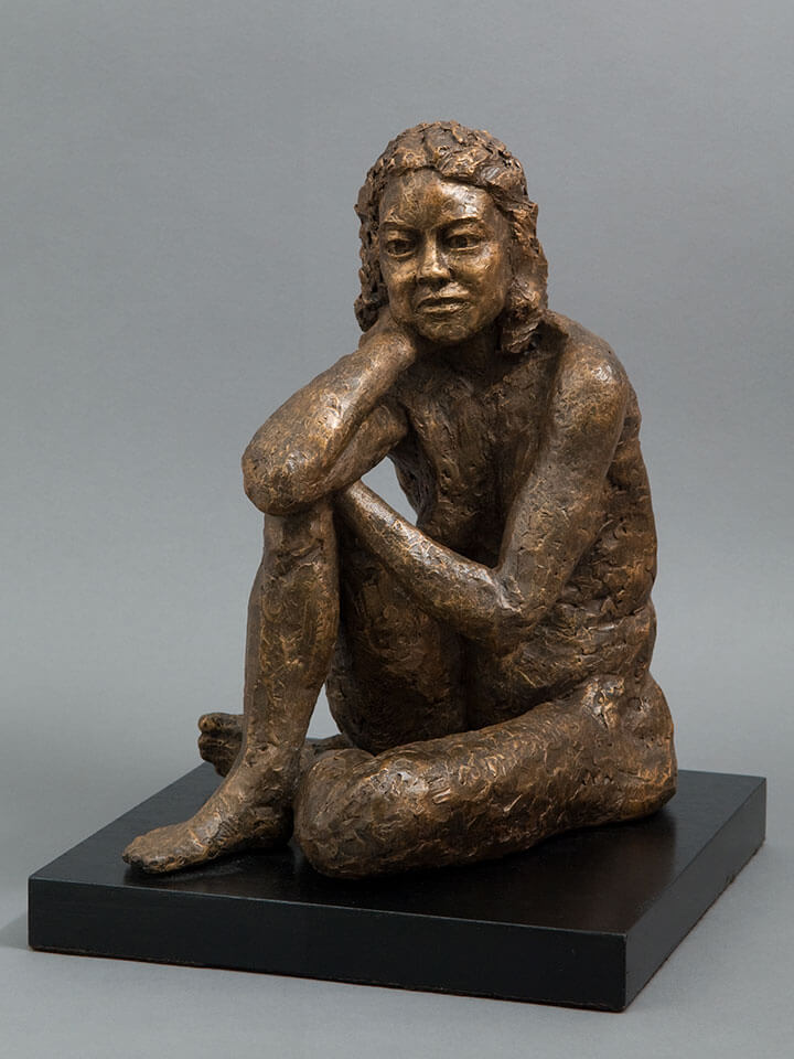 Female seated figure leaning on right knee in cast resin by William Casper.