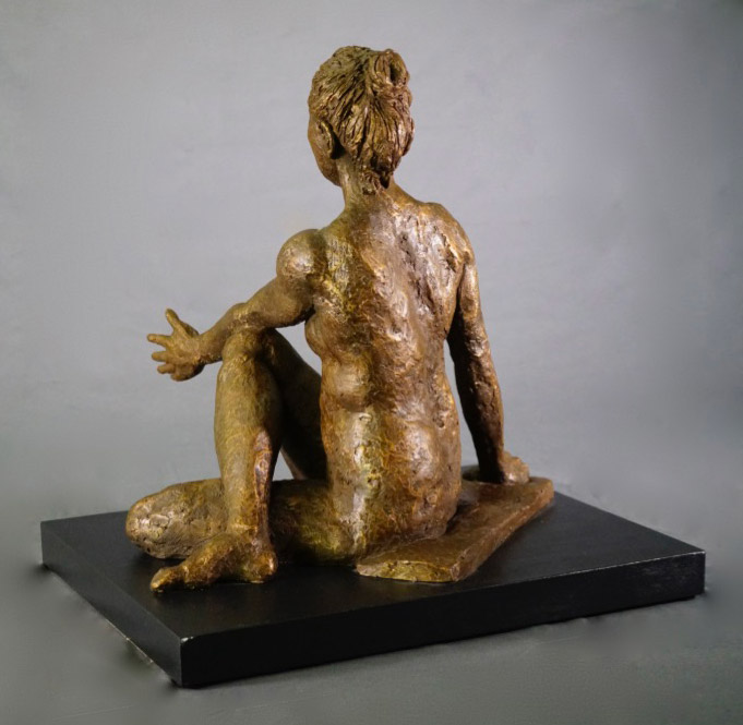 Female in seated and twisted Lord of the Fishes yoga pose in cast resin rear view by William Casper.