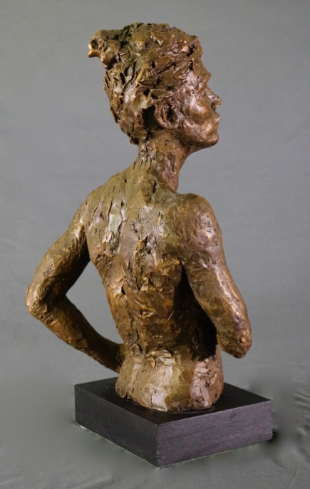 Female waist high with right arm crossed rear view in cast resin by William Casper.