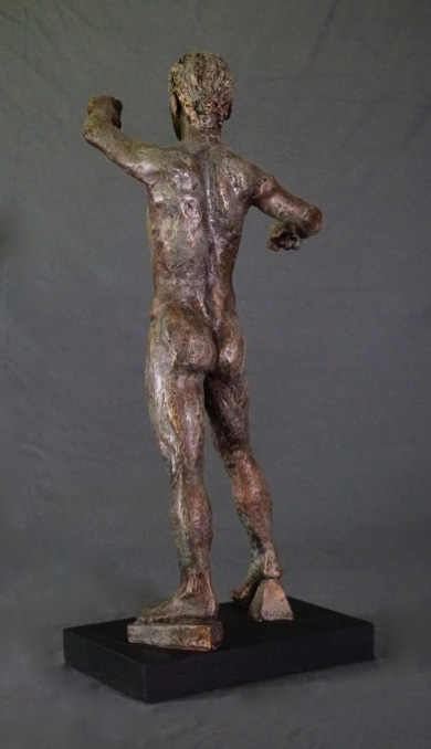 Standing male with clenched hands rear view in cast resin by William Casper.